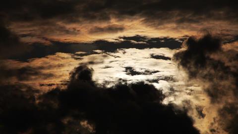 dark sky flameSun behind dark clouds Stock Video Footage