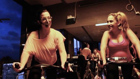 Spinning class workout wellbeing Woman doing fitne Footage
