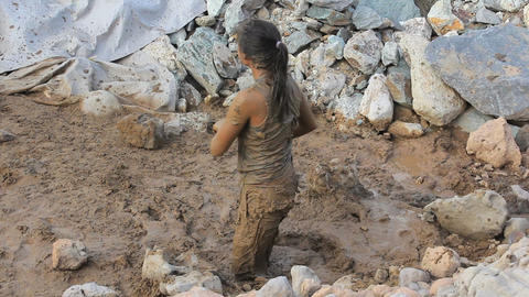Crazy Girl Having Mud Fight With Her Friend Stock Video Footage