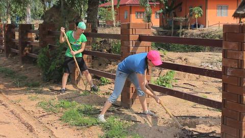 Girls Hard At Work Digging Holes Stock Video Footage