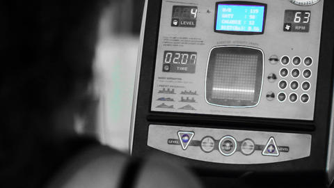people at the gym exercising on a cross trainer Tr Stock Video Footage