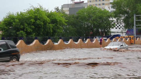 flooding in town streets after torrential rain Stock Video Footage