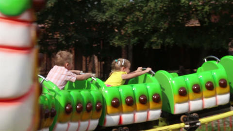 children ride on attraction in park - carousel sli Stock Video Footage