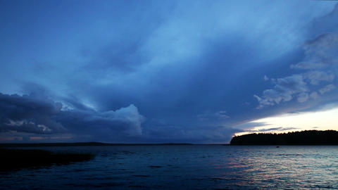 approaching storm on lake after sunset - timelapse Stock Video Footage