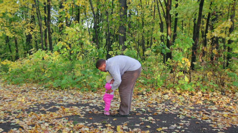 Father Playing With Baby In Autumn Park stock footage