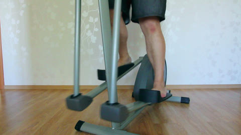 overweight man legs exercising on trainer ellipsoi Stock Video Footage