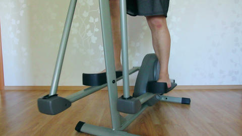 overweight man legs exercising on trainer ellipsoi Footage