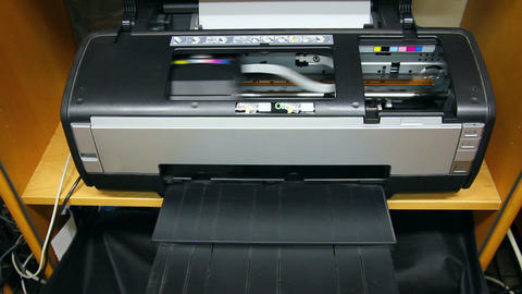 Inkjet printer color photo prints - timelapse Stock Video Footage