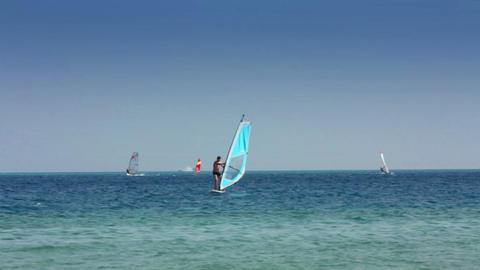 windsurfing - man learns to ride on windsurfer Stock Video Footage