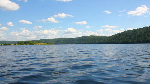 summer lake with waves under blue sky Stock Video Footage