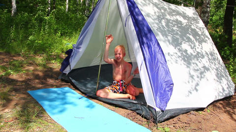 boy near camping tent in forest Stock Video Footage
