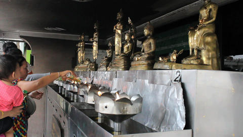 Pouring Oil At Buddhist Temple Footage