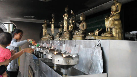Pouring Oil At Buddhist Temple Stock Video Footage