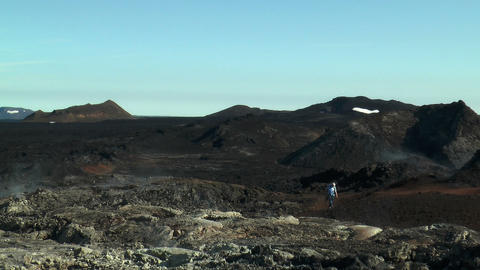 Tourist Walking Trough Volcanic Area In Iceland stock footage
