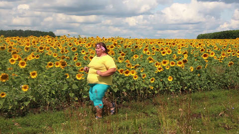 fitness - overweight woman running along field of Footage