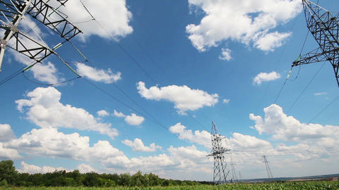 panorama with tall electric masts against cloudy s Stock Video Footage
