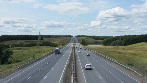 cars traveling on highway - zoom timelapse Stock Video Footage