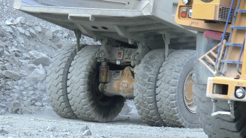 Heavy mining dump trucks moving along the opencast Footage