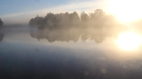 fog and sun on the river Footage