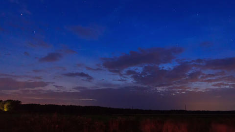 Sunset, then the stars and clouds. Time Lapse Stock Video Footage