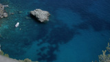 Boat In Clear Water Of Azure Bay In Capri Italy stock footage