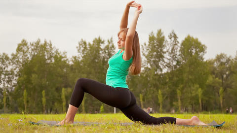 Woman Exercising In A Meadow stock footage