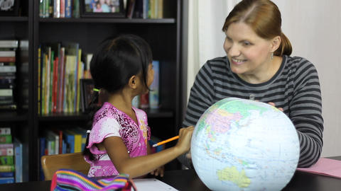 Homeschool Mom Teaching Asian Daughter Geography Stock Video Footage