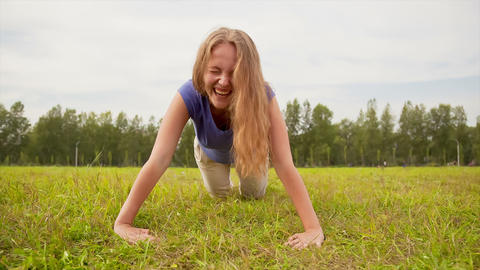 Woman exercising in a meadow Footage