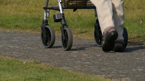 Retiree Pensioner Walk Away Defocus 2 Shots 11076 stock footage