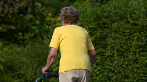 retiree pensioner walk away defocus 2 shots 11076 Stock Video Footage