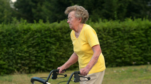 pensionerwalk by with nice DOF 11080 Stock Video Footage
