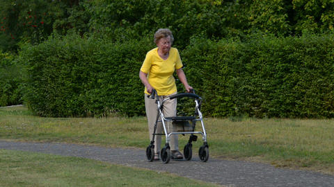 pensioner walk and watch with rollator 11082 Stock Video Footage