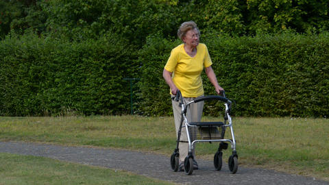 pensioner walk and watch with rollator 11082 Footage