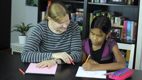 Homeschool Mom Teaching Asian Daughter Art Lesson Footage