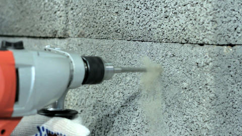Drilling hole into concrete wall Stock Video Footage