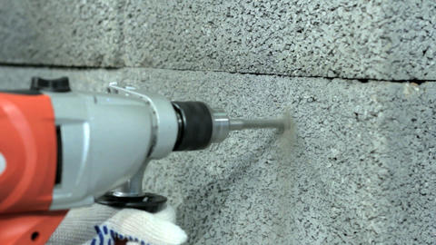 Drilling Hole Into Concrete Wall stock footage
