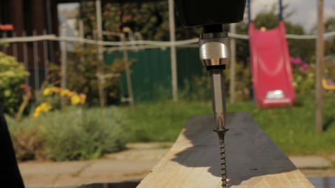 Electric screwdriver screwing screw in wood Stock Video Footage