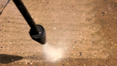 Cleaning dirty patio with pressure washer. Close U Stock Video Footage
