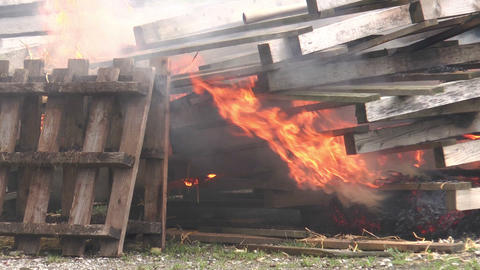 stack of transport pallets burning Footage