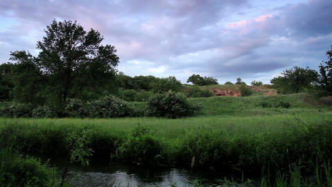 Movement of clouds over the river Stock Video Footage