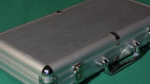 Hands open the aluminium suitcase with poker set Stock Video Footage