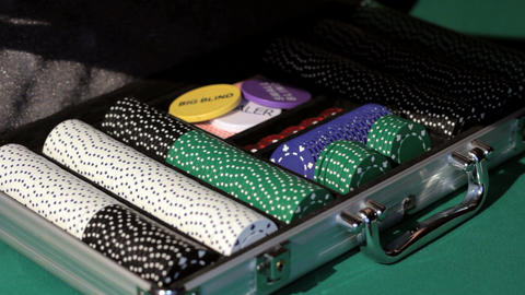 Hands open the aluminium suitcase with poker set Footage