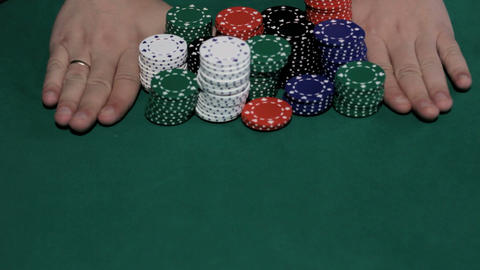 Poker player going all-in Stock Video Footage
