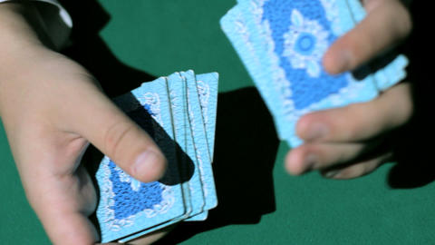 Two Hands, Shuffling A Deck Of Cards stock footage