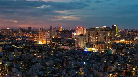 4k - CITY SUNSET - ZOOM on HO CHI MINH CITY TIME Stock Video Footage