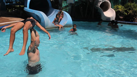 Boy Being Tossed At The Water Park Stock Video Footage
