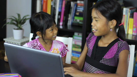 Two Asian Girls Surfing The Internet On Laptop Stock Video Footage
