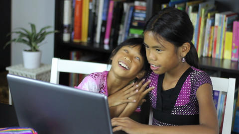Two Asian Girls Surfing The Internet On Laptop Footage