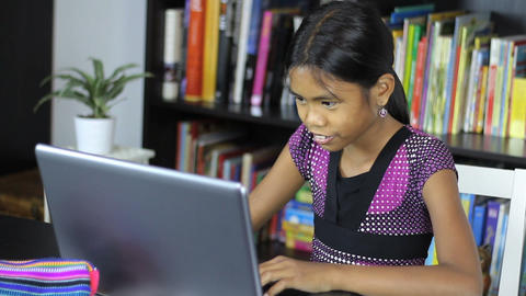 Young Asian Girl Using Her Laptop Computer Stock Video Footage