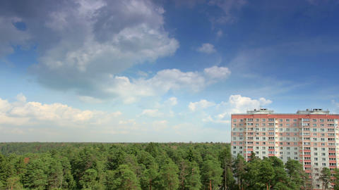 Movement of clouds over the forest, high-rise buil Stock Video Footage